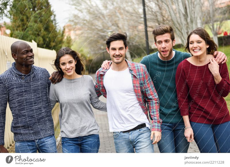 Group of multi-ethnic young people walking together outdoors Lifestyle Joy Happy Academic studies Human being Woman Adults Man Friendship 5 18 - 30 years