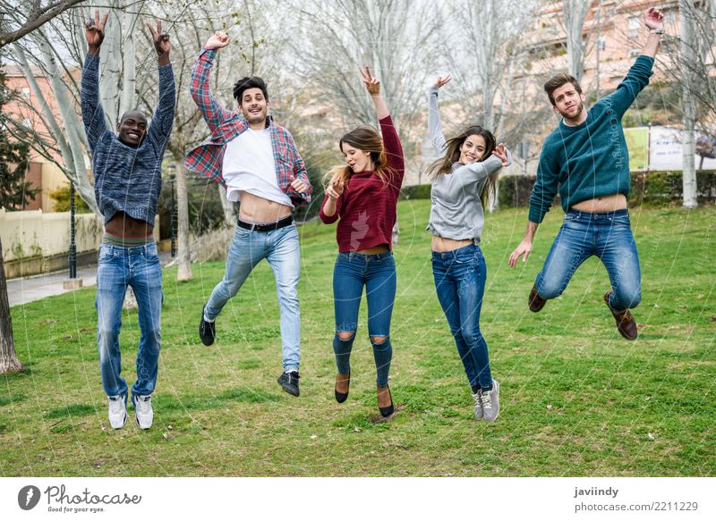 Multiracial young people jumping together outdoors Woman Human being Youth (Young adults) Man Young woman Young man Joy 18 - 30 years Adults Lifestyle Group