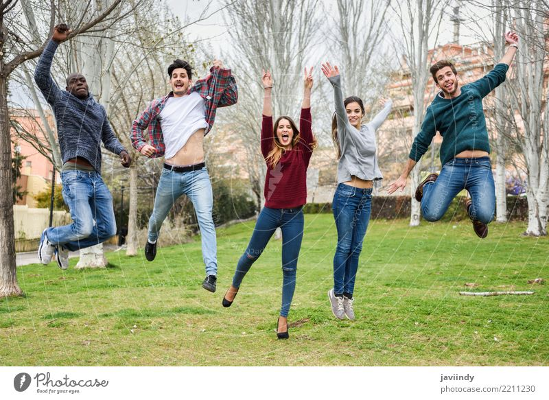 Multiracial young people jumping together outdoors Woman Human being Youth (Young adults) Man Young woman Young man Joy 18 - 30 years Adults Street Lifestyle