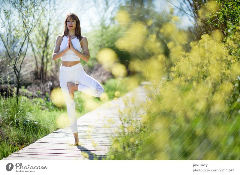 Young woman doing yoga on wooden road in nature. Lifestyle Happy Beautiful Body Relaxation Meditation Summer Sports Yoga Human being Feminine Woman Adults 1