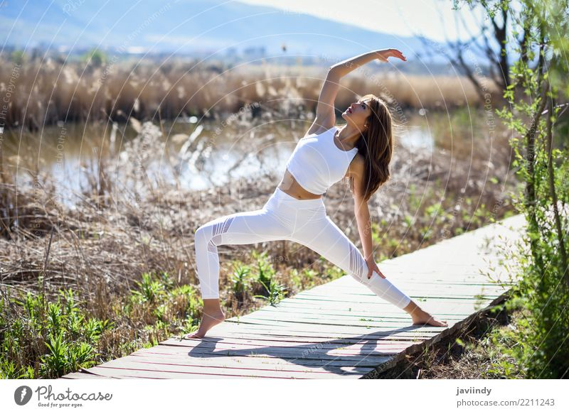 Young woman doing yoga on wooden road in nature. Lifestyle Beautiful Body Relaxation Meditation Sun Sports Yoga Human being Feminine Youth (Young adults) Woman