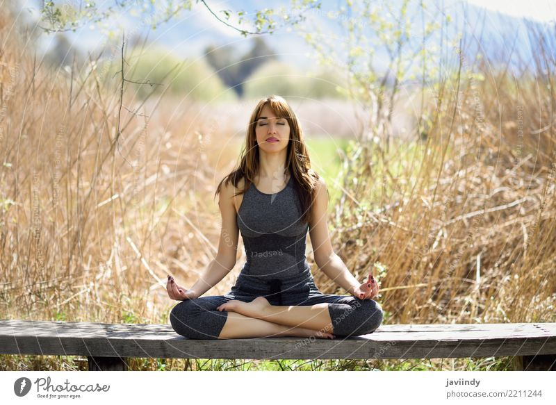 Young woman doing yoga in nature. Lifestyle Beautiful Body Relaxation Meditation Summer Sports Yoga Human being Feminine Youth (Young adults) Woman Adults 1