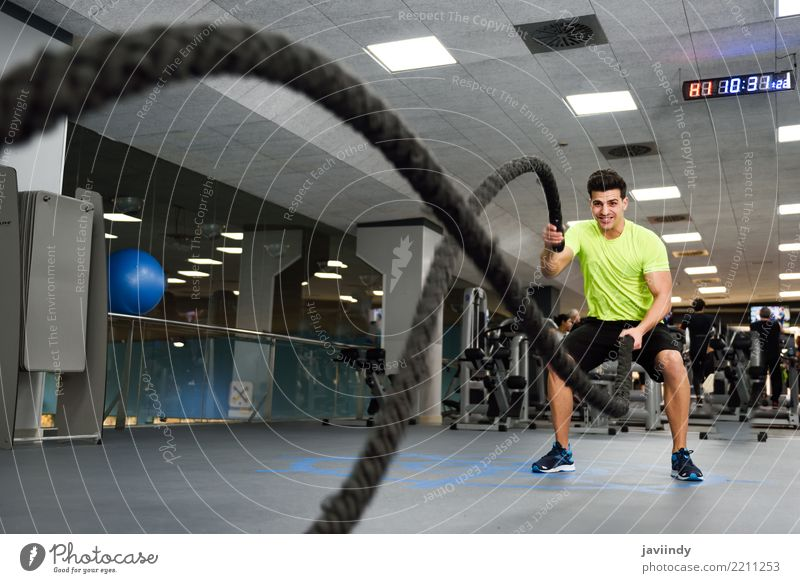 Man with battle ropes exercise in the fitness gym Human being Youth (Young adults) Beautiful Joy 18 - 30 years Adults Sports Friendship Masculine Body Waves