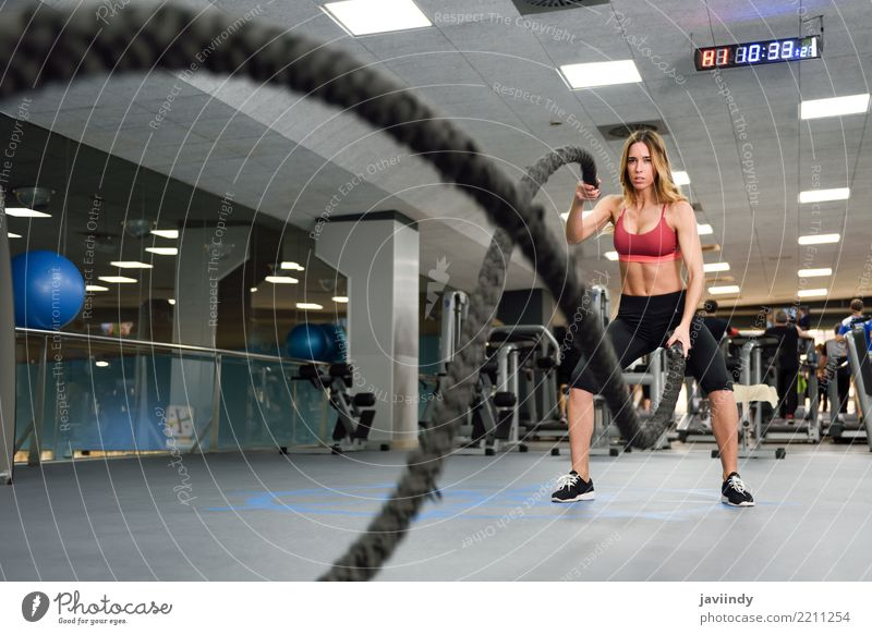 Woman with battle ropes exercise in the fitness gym. Joy Beautiful Body Waves Club Disco Sports Climbing Mountaineering Human being Feminine Adults Friendship 1