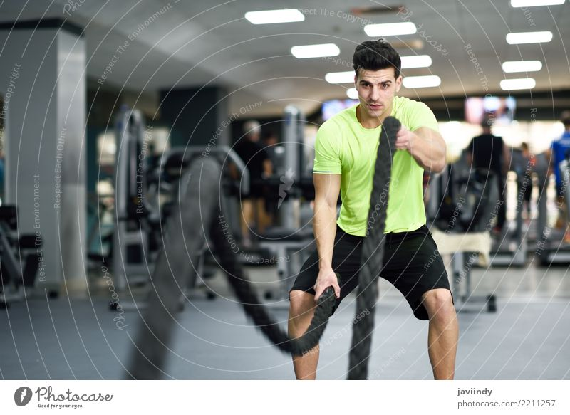 Man with battle ropes exercise in the fitness gym. Human being Youth (Young adults) Beautiful Joy 18 - 30 years Adults Sports Friendship Masculine Body Waves