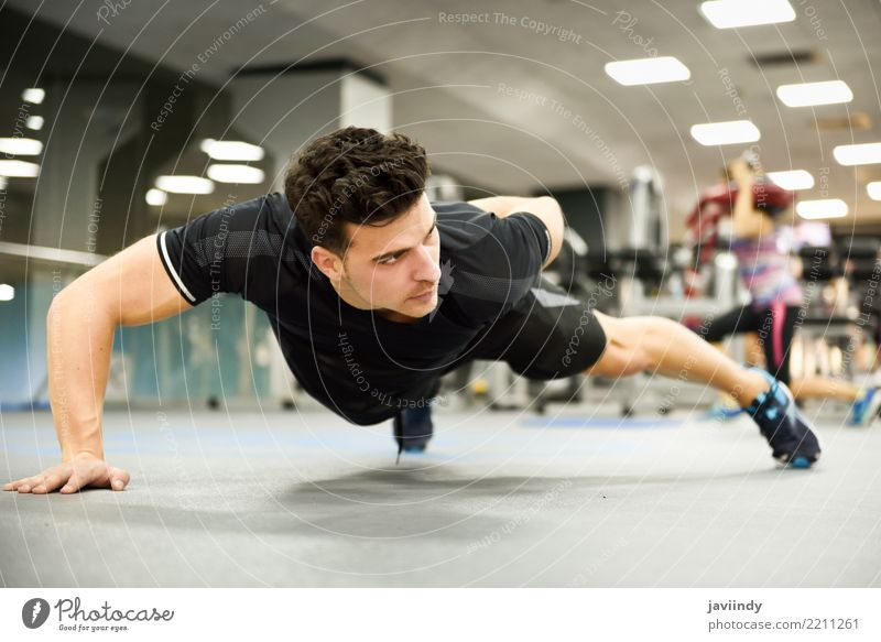 Attractive man doing pushups in the gym Lifestyle Beautiful Body Sports Human being Masculine Man Adults 1 18 - 30 years Youth (Young adults) Fitness Thin