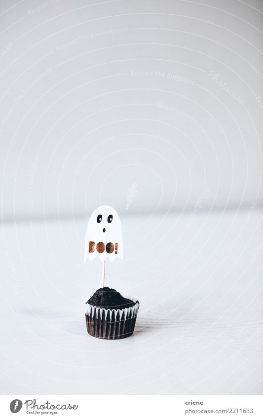 Halloween chocolate cupcake on white background Decoration Eating Hallowe'en Accessory White Cupcake food Ghosts & Spectres  kids mimimalism Minimalistic Spooky