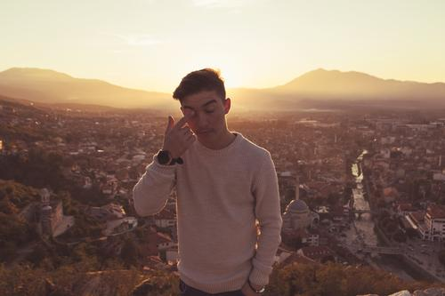 To shed a tear Human being Masculine Youth (Young adults) 1 13 - 18 years Sunrise Sunset Sunlight Warmth Hill Prizren Kosovo Europe Town Outskirts Sweater Cry