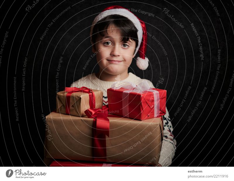 happy child with gifts at christmas Lifestyle Shopping Vacation & Travel Winter Party Event Feasts & Celebrations Christmas & Advent New Year's Eve Human being