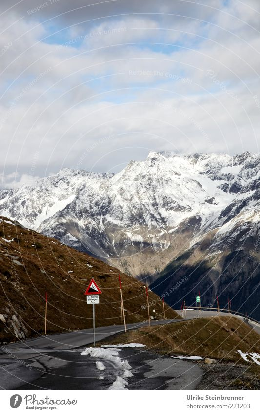 Nature Beautiful Vacation & Travel Clouds Snow Autumn Mountain Landscape Road traffic Rock Dangerous Alps Traffic infrastructure Downward Warning label Glacier