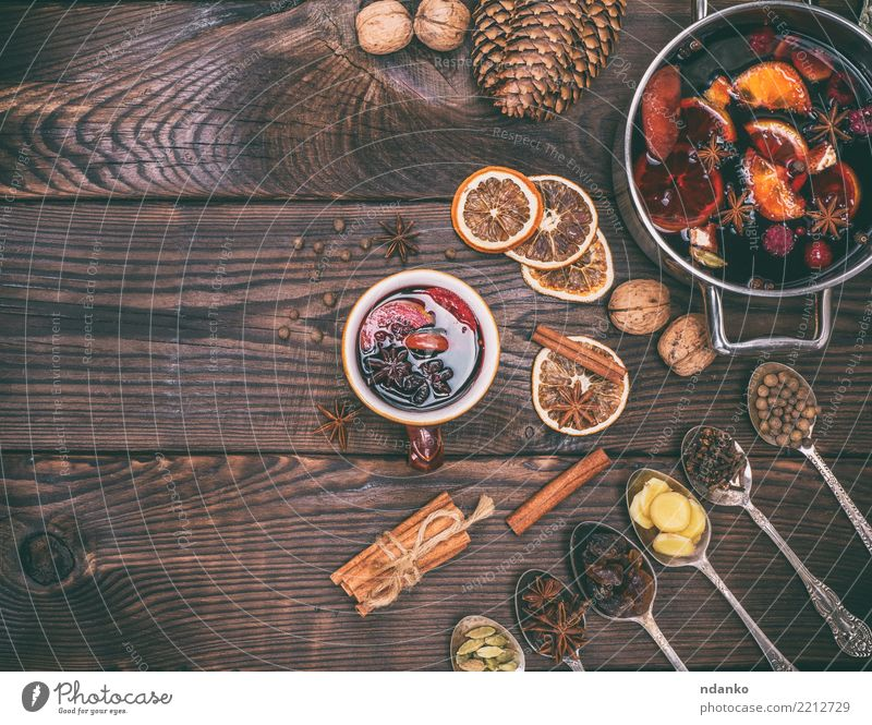 mulled wine and ingredients in iron spoons Christmas & Advent Red Wood Feasts & Celebrations Brown Fruit Decoration Table Paper Herbs and spices Beverage Hot