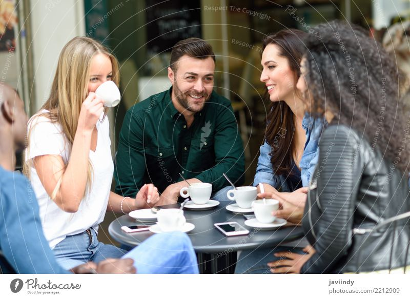Multiracial group of five friends having a coffee together. Woman Human being Youth (Young adults) Man Summer Beautiful Joy 18 - 30 years Adults Lifestyle