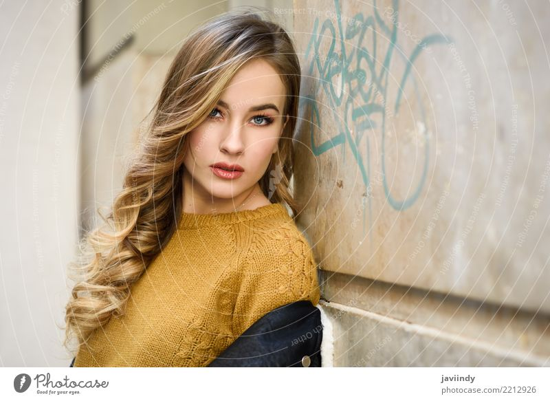 Blonde woman in urban background Lifestyle Style Beautiful Hair and hairstyles Face Winter Human being Woman Adults Autumn Street Fashion Skirt Sweater Jacket