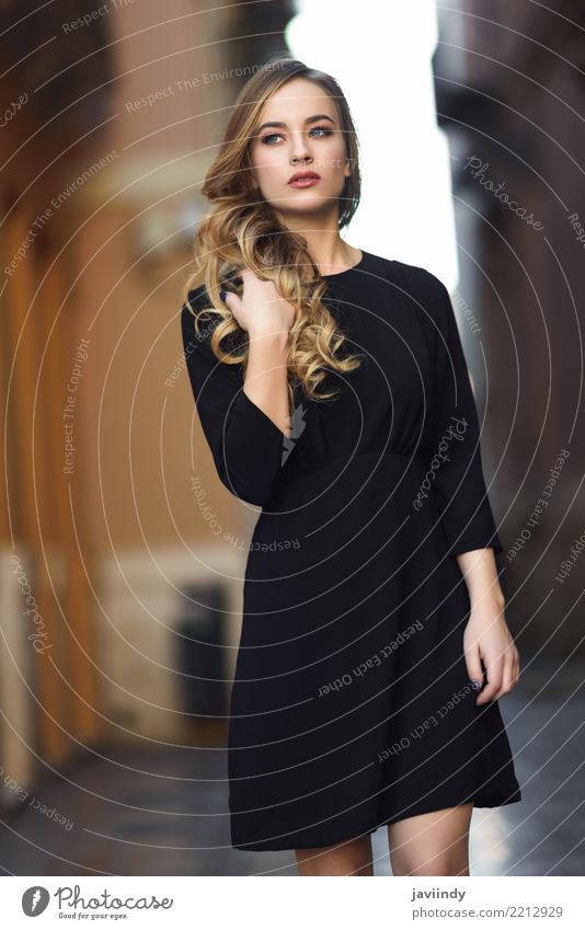 Blonde woman in urban background wearing black dress Lifestyle Style Beautiful Hair and hairstyles Face Human being Feminine Woman Adults 1 18 - 30 years