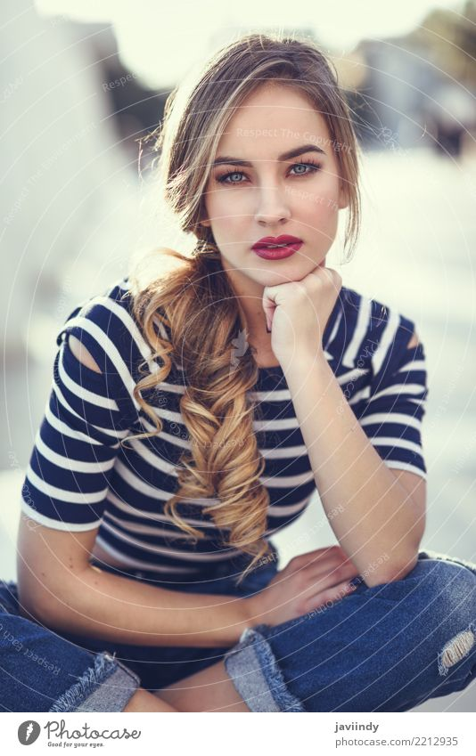 Blonde woman sitting on a bench in urban background. Lifestyle Happy Beautiful Hair and hairstyles Summer Human being Woman Adults Street Fashion Shirt Jeans