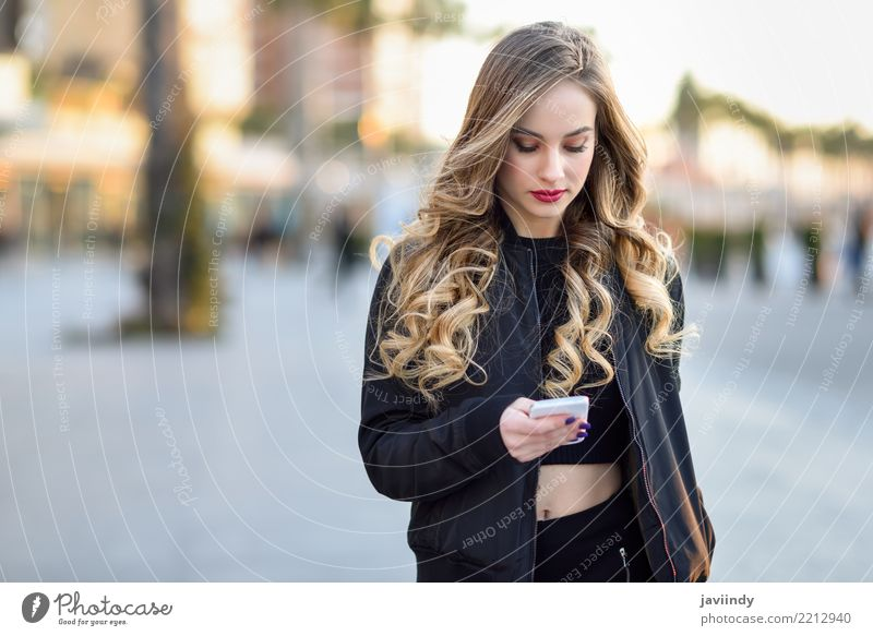 Blonde woman texting with her smartphone Lifestyle Style Beautiful Hair and hairstyles Telephone PDA Human being Feminine Woman Adults 1 18 - 30 years