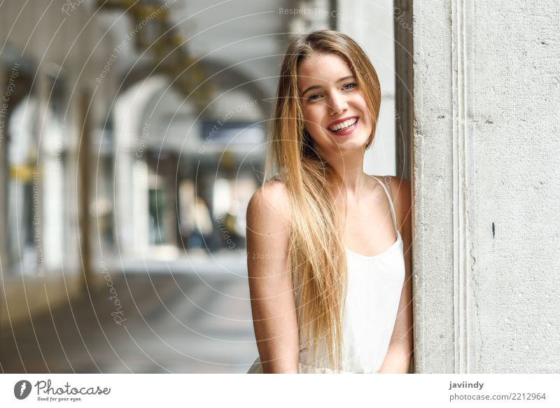 Blonde girl in urban background wearing white dress Lifestyle Happy Beautiful Hair and hairstyles Face Summer Human being Feminine Woman Adults