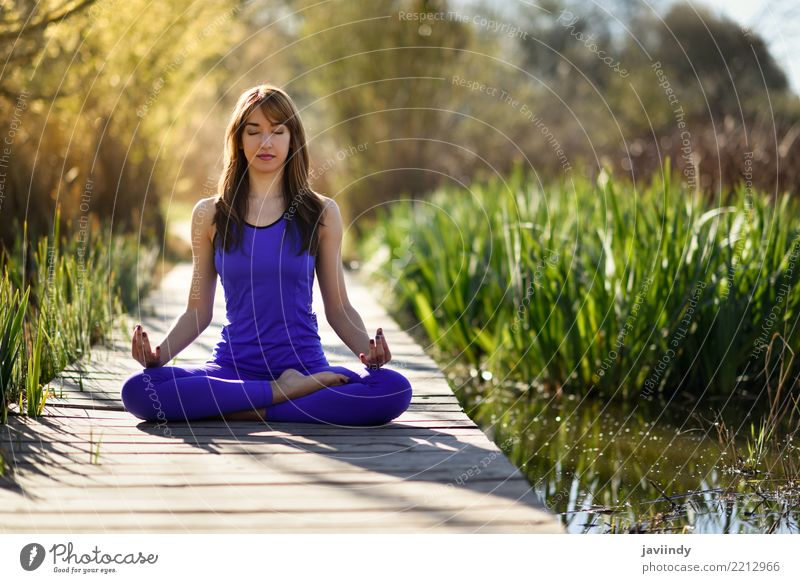 Young woman doing yoga on wooden road in nature Lifestyle Beautiful Body Relaxation Meditation Summer Sports Yoga Human being Feminine Woman Adults 1