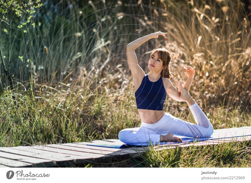Young woman doing yoga on wooden road in nature Lifestyle Beautiful Body Wellness Relaxation Meditation Sports Yoga Human being Feminine Woman Adults 1