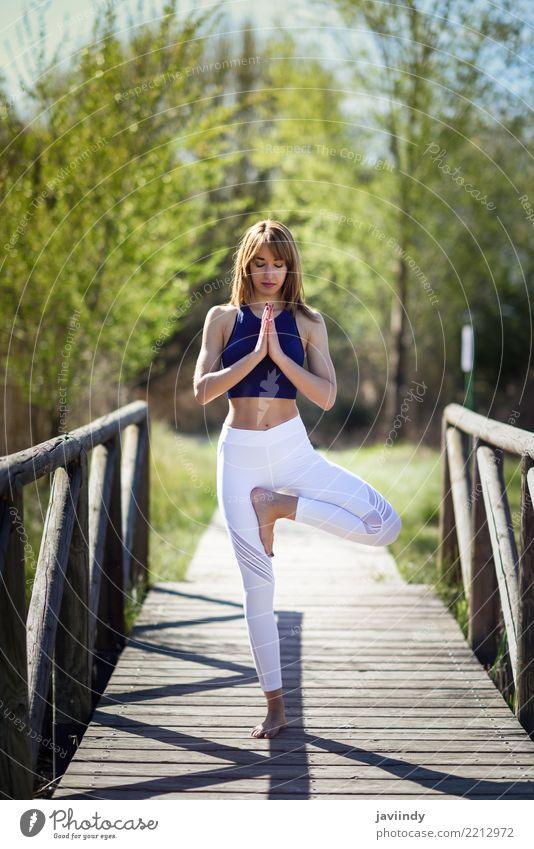 Young woman doing yoga on wooden bridge in nature. Lifestyle Happy Beautiful Body Relaxation Meditation Summer Sports Yoga Human being Feminine Woman Adults 1