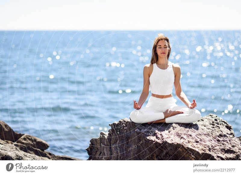 Young woman doing yoga in the beach. Lifestyle Beautiful Wellness Relaxation Meditation Summer Beach Ocean Sports Yoga Human being Woman Adults Nature Fitness