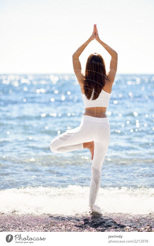 Young woman doing yoga in the beach Woman Human being Nature Youth (Young adults) Summer Beautiful White Tree Ocean Relaxation Beach 18 - 30 years Adults