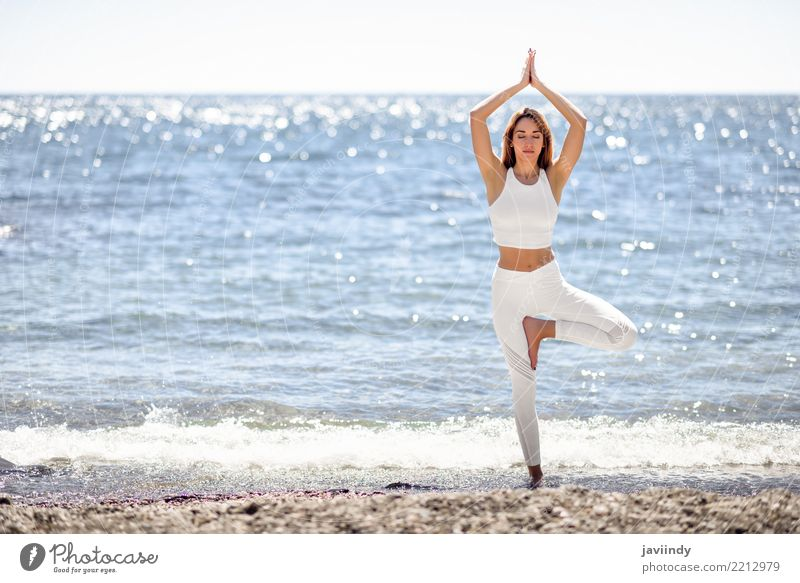 Young woman doing yoga in the beach. Woman Human being Nature Summer Beautiful White Ocean Relaxation Beach Adults Lifestyle Natural Sports Happiness Energy