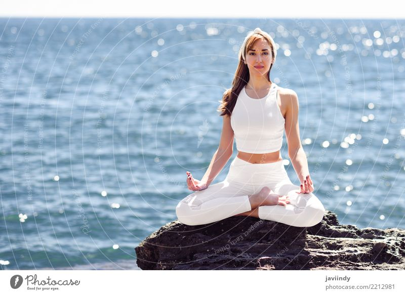 Young woman doing yoga in the beach Lifestyle Beautiful Wellness Relaxation Meditation Summer Beach Ocean Sports Yoga Human being Feminine Woman Adults Body 1