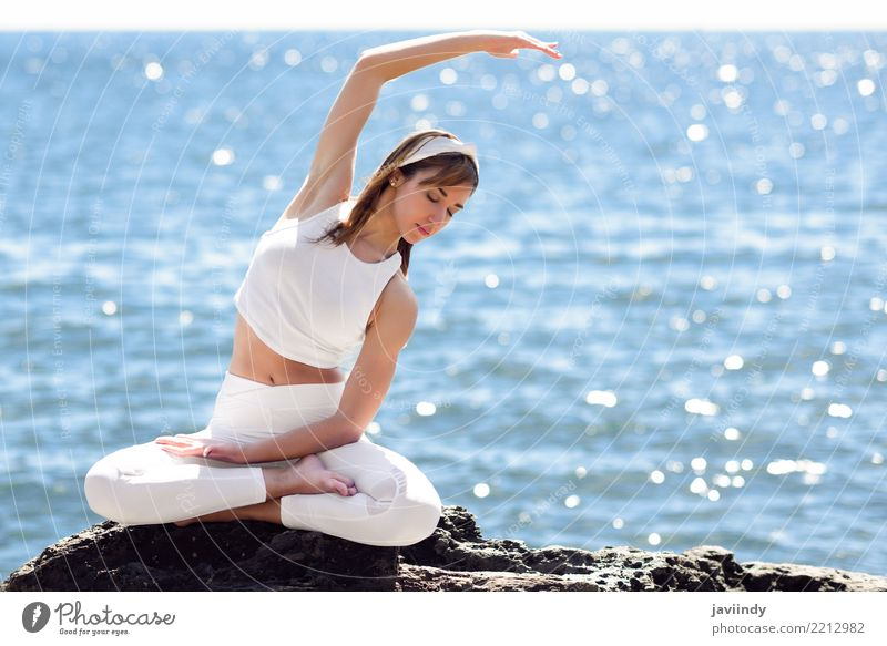 Young woman doing yoga in the beach. Lifestyle Beautiful Wellness Relaxation Meditation Summer Beach Ocean Sports Yoga Human being Feminine Woman Adults 1