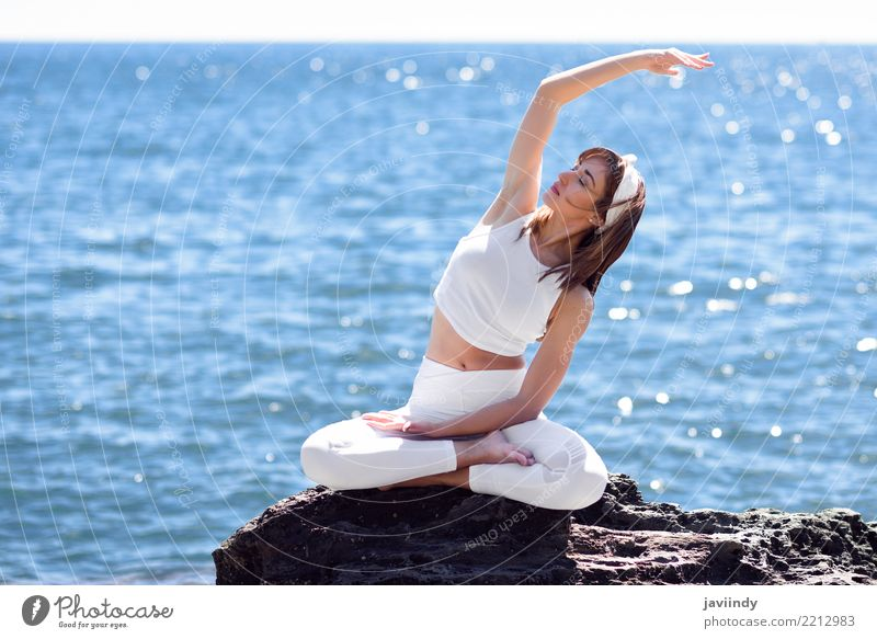 Young woman doing yoga in the beach. Woman Human being Nature Summer Beautiful White Ocean Relaxation Beach Adults Lifestyle Natural Sports Sit Happiness Energy