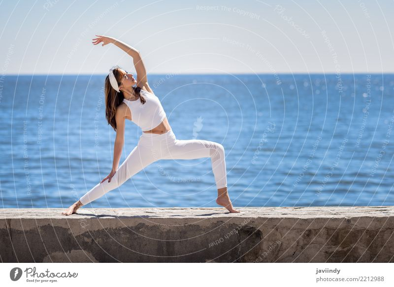 Young woman doing yoga in the beach. Lifestyle Beautiful Wellness Relaxation Meditation Summer Beach Ocean Sports Yoga Human being Feminine Woman Adults Body 1