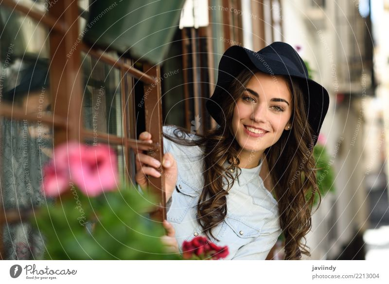 Young woman smiling with hat near a window Lifestyle Elegant Style Happy Beautiful Hair and hairstyles Face Human being Woman Adults Street Fashion Shirt Hat
