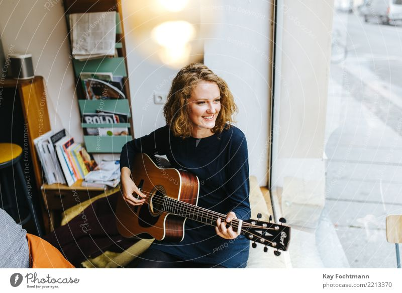 Young smiling singer with guitar Lifestyle Joy Happy Harmonious Well-being Contentment Relaxation Feminine Young woman Youth (Young adults) 1 Human being