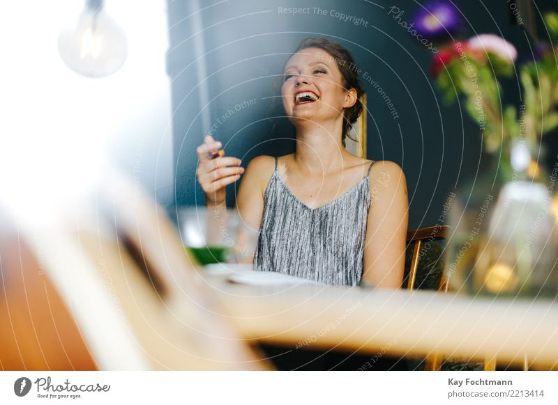 woman laughing in a café Lifestyle Joy luck Feminine Young woman Youth (Young adults) 1 Human being 18 - 30 years Adults Dress Blonde Long-haired braid Laughter