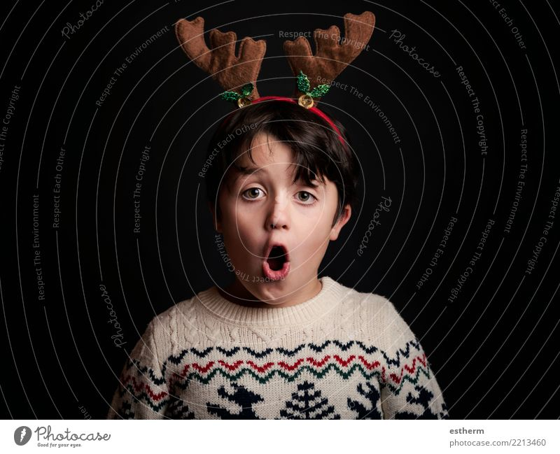 surprised child on christmas Lifestyle Vacation & Travel Winter Entertainment Party Event Feasts & Celebrations Christmas & Advent New Year's Eve Human being
