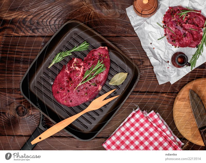 fresh beef steak with rosemary Meat Herbs and spices Dinner Fork Table Paper Wood Fresh Green Red Beef Blood Chop Cut Gourmet Ingredients Loin Meal napkin