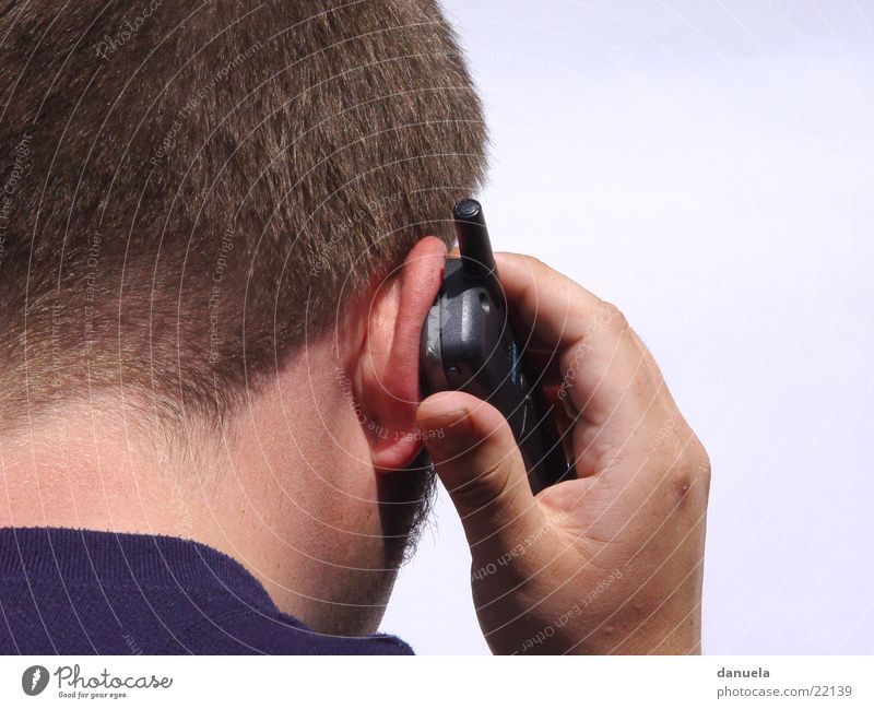 I here - who there? Man Hand Cellphone Backwards Telephone To talk To call someone (telephone)