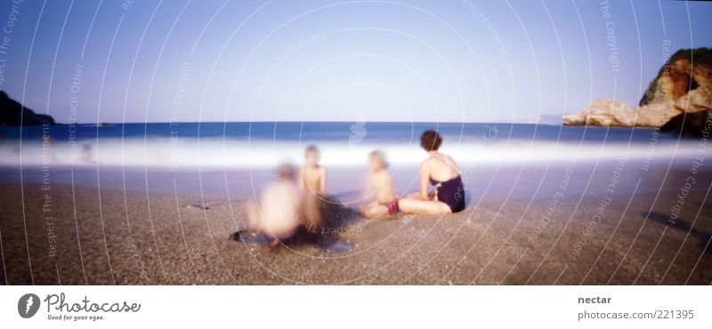 Human being Child Sky Nature Water Summer Beach Vacation & Travel Ocean Far-off places Freedom Landscape Environment Sand Group Coast