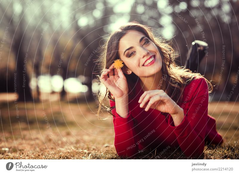 Woman rest in the park with a dandelion in her hair Human being Nature Summer Beautiful Flower Red Relaxation Face Adults Lifestyle Style Grass Happy