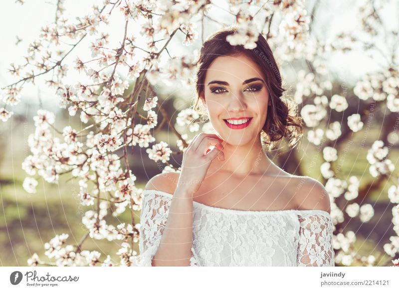 Woman smiling in the flowered garden in the spring time Style Happy Beautiful Hair and hairstyles Face Wedding Human being Adults Nature Tree Flower Blossom