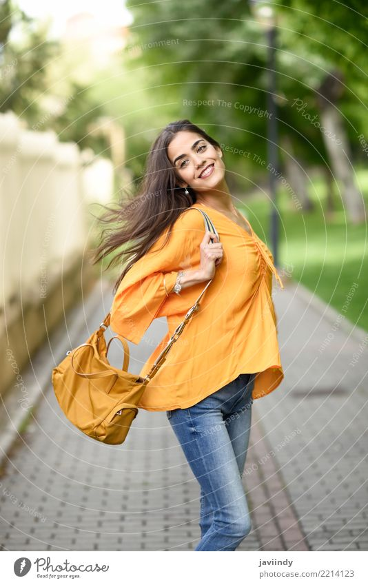 Young woman with moving hair wearing casual clothes Lifestyle Style Happy Beautiful Hair and hairstyles Human being Woman Adults Wind Street Fashion Clothing