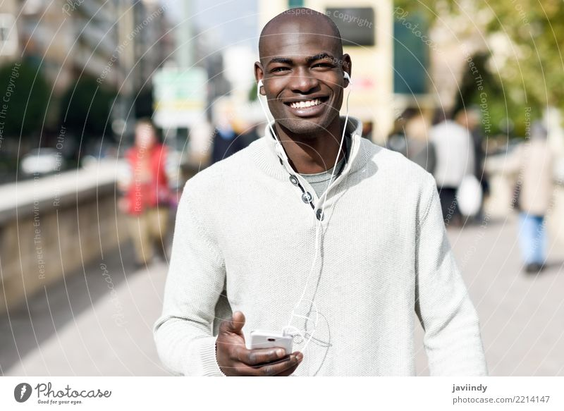 Black young man with a smartphone in his hand Lifestyle Happy Beautiful Face Telephone PDA Technology Human being Man Adults 1 18 - 30 years