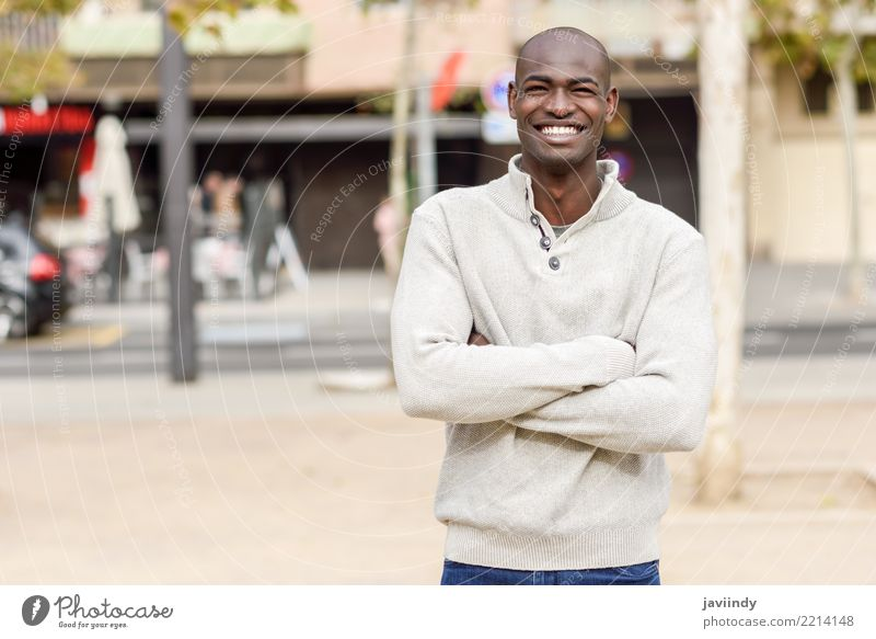 Black young man with arms crossed smiling in urban background Human being Youth (Young adults) Man Beautiful 18 - 30 years Face Adults Street Lifestyle Happy