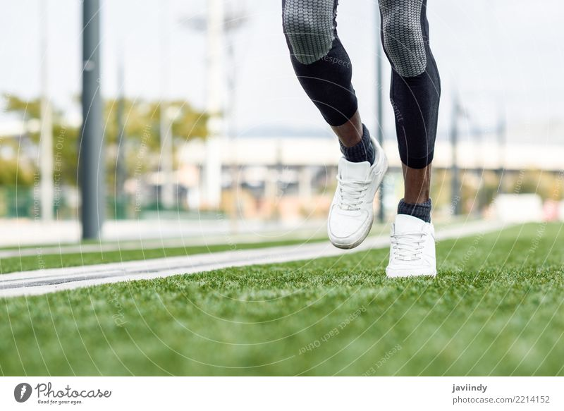 Feet of black man starting running in urban background. Lifestyle Sports Jogging Human being Man Adults Sneakers Fitness Muscular Black african leg athlete