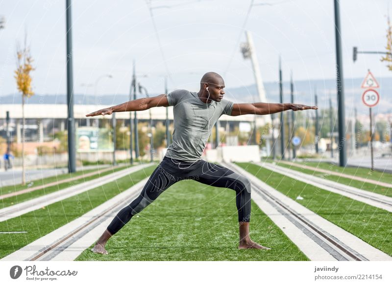 Black man practicing yoga in urban background. Human being Youth (Young adults) Man Beautiful Relaxation 18 - 30 years Adults Lifestyle Sports Body Action