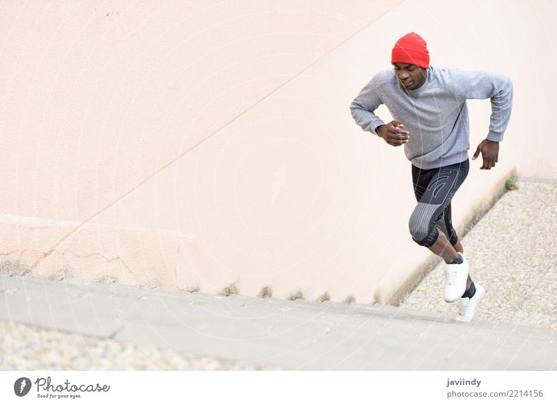 Black man running upstairs outdoors Human being Man Winter Adults Lifestyle Sports Body Power Action Fitness Guy Muscular Runner Jogging Practice