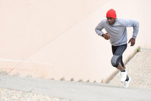 Black man running upstairs outdoors Lifestyle Body Winter Sports Jogging Human being Man Adults Fitness Muscular Power steps Runner healthy fit workout young
