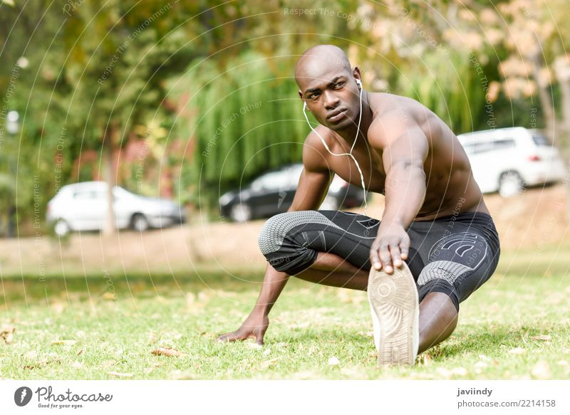 Young black man doing stretching after running in urban park. Lifestyle Body Sports Human being Masculine Man Adults 1 18 - 30 years Youth (Young adults)
