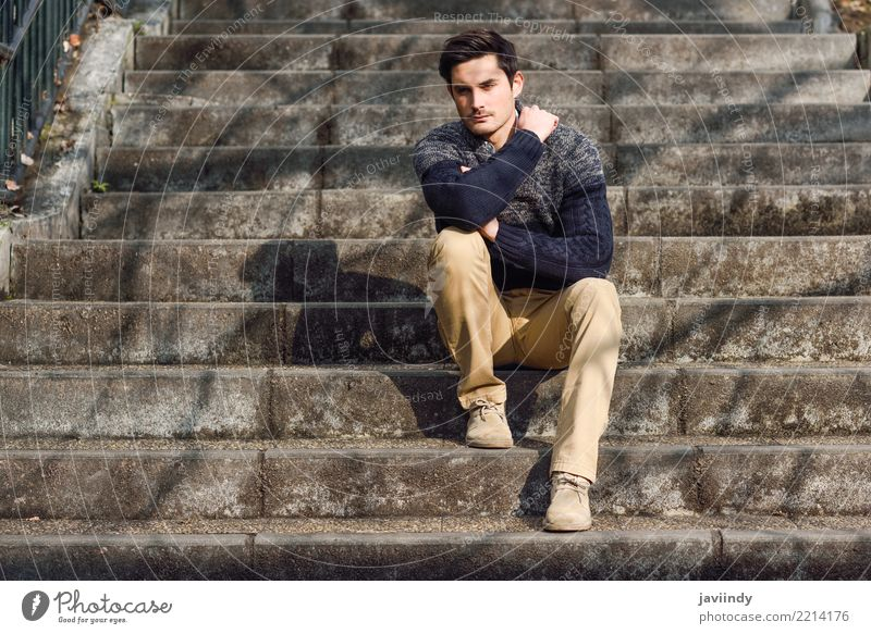 Young man with modern hairstyle sitting on stairs Lifestyle Style Hair and hairstyles Face Human being Man Adults Autumn Fashion Sweater Cool (slang) Good