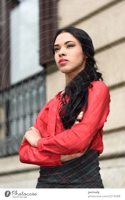 Young Hispanic bussinesswoman in urban background Business Human being Woman Adults Street Flight Attendant Shirt Skirt Brunette Red Black Businesswoman girl